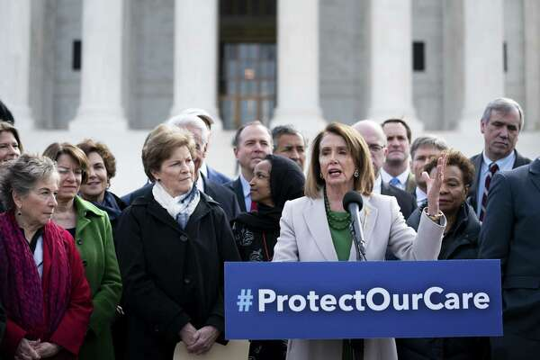 House Speaker Nancy Pelosi speaks at a news conference in front of the Supreme Court in Washington, April 2. The House voted to condemn the Trump administration for pushing a federal appeals court to obliterate the Affordable Care Act, and it urged the Justice Department to defend the law in court.