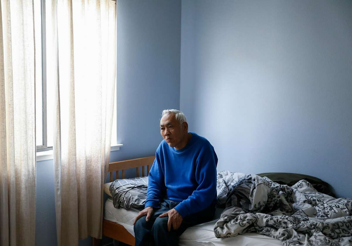 Resident Jin Xue relaxes in his bedroom at Aurora Concepcion's Residential Care Home in San Francisco, Calif. Friday, April 5, 2019.