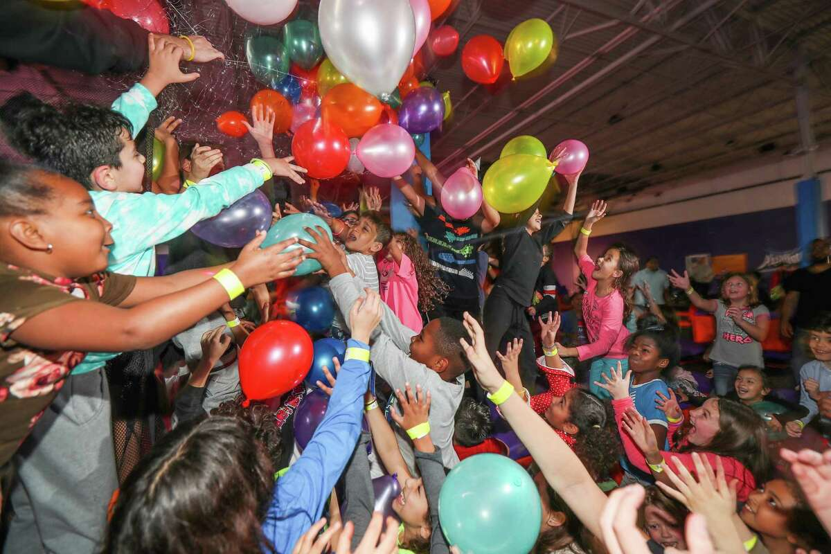 More than 200 youths enjoy a balloon drop during the New Year's Eve Glow Light party at Altitude Trampoline Park in Sugar Land. The number of trampoline parks has skyrocketed.