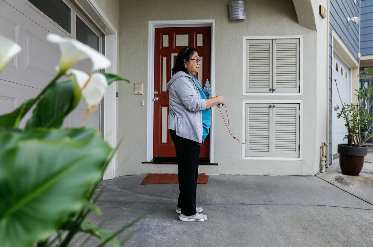 Aurora Concepcion enters the second building of her Residential Care Home in San Francisco, Calif. Friday, April 5, 2019.