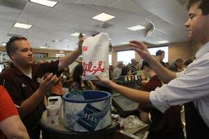 A customer picks up his lunch Aug. 1, 2012 at the Chick-fil-A restaurant on Loop 410 at McCollough. The San Antonio City Council recently barred the restaurant from a site at the airport, a move denounced as anti-Christian and anti-inclusion.