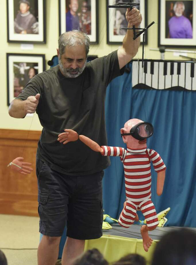 "The Robert Rogers Puppet Company will present the story of ""The Reluctant Dragon"" from 10:30 to 11:30 a.m. Mondayat the Byram Shubert Library. In the show, a boy befriends a peaceful, poetry-loving dragon in the hills beyond the village, but when the townsfolk find out and hire a knight to slay the dragon, the boy comes up with a clever plan: the ""pretend"" tournament of the century! Can a boy, a knight, and a dragon pull this off so that everyone gets their happy ending? The show, part of the spring break lineup of events, is free. Photo: Tyler Sizemore / Hearst Connecticut Media / Greenwich Time"