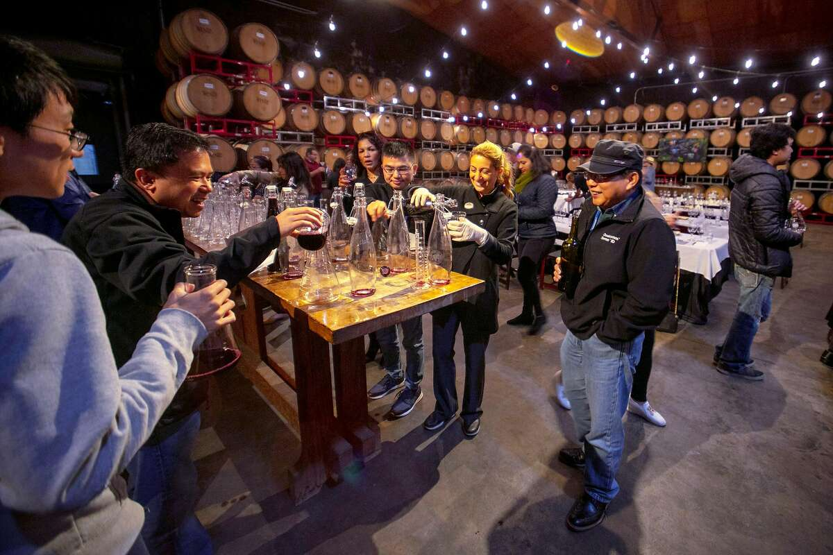 Guest mix up their own blends at The Wine Makers Workshop at Wente wines Friday 12 April 2019 in Livermore, CA.
