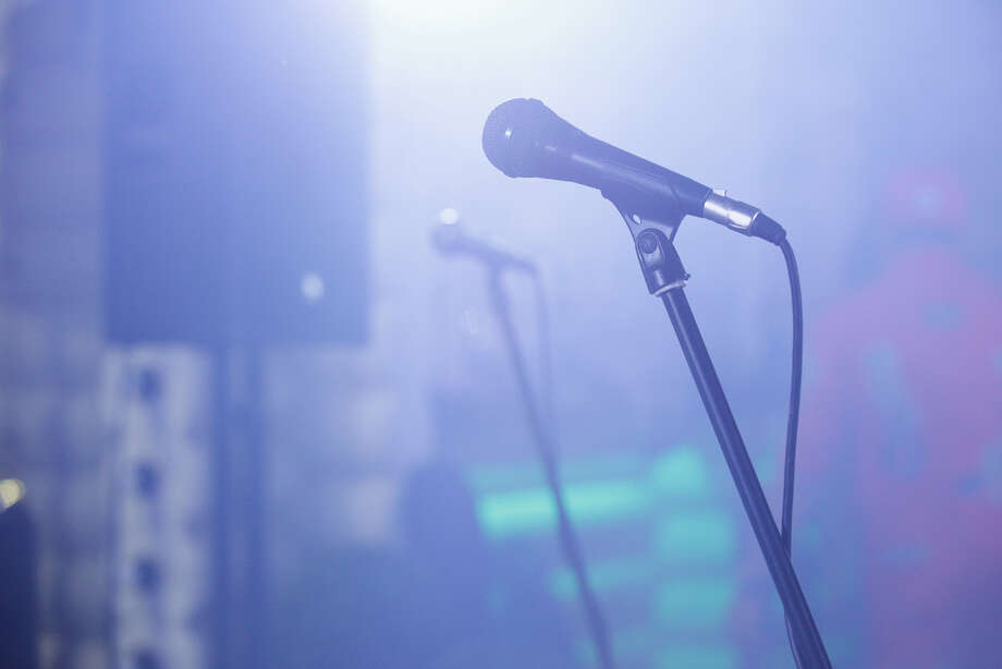 A microphone on a stage. Photo: Scharfsinn86 / Getty Images