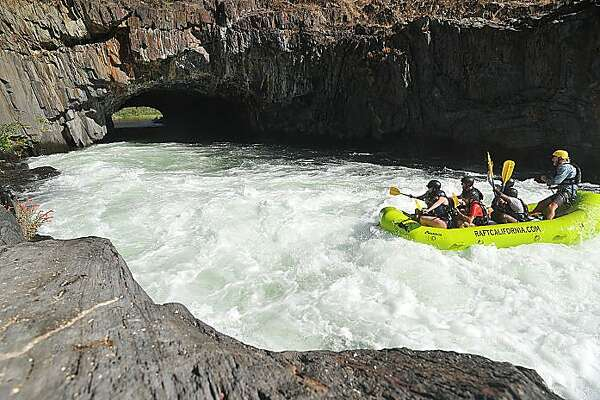 Rafters head through the Tunnel Chute on the Middle Fork of the American River.