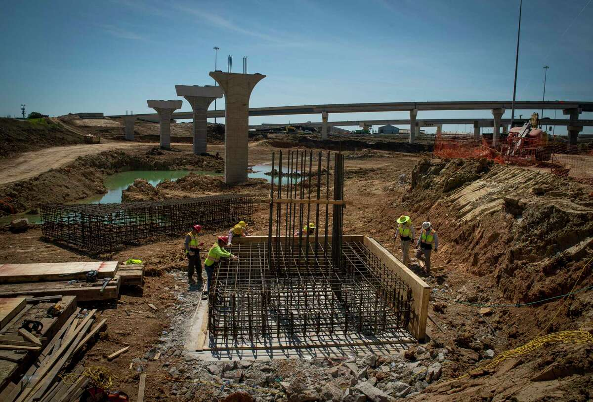A larger detention pond is being created underneath what will be a flyover from Loop 610 to the new tollway along Texas 288, seen on March 27, 2019 in Houston.
