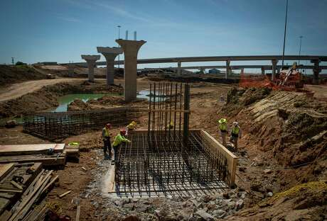 A new detention pond is taking shape beneath what will be a flyover from Loop 610 to the new tollway along Texas 288 on March 27.