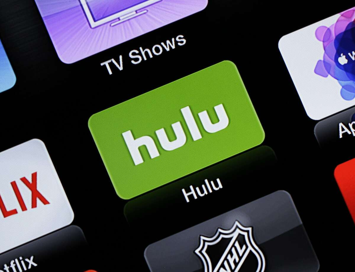 FILE- This June 24, 2015, file photo shows the Hulu Apple TV app icon in South Orange, N.J. There are more TV streaming services than ever before and more people are opting to drop cable in favor of streaming services. But monthly subscriptions can add up fast. A little research on which services are best for you can help save big bucks.(AP Photo/Dan Goodman, File)