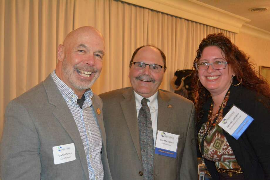 From left: City Planner Marty Connor, Veteran's Memorial Committee Chairman Leo Martigneni and Jennifer Williams of BantamWesson Energy. Photo: Leslie Hutchison / Hearst Connecticut Media /