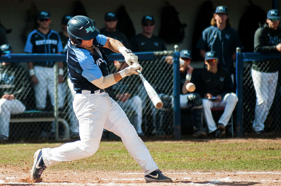 Northwood's Nick Palmer swings on a pitch during a game against SVSU on Friday, April 12, 2019 at Northwood University. (Katy Kildee/kkildee@mdn.net) Photo: (Katy Kildee/kkildee@mdn.net)