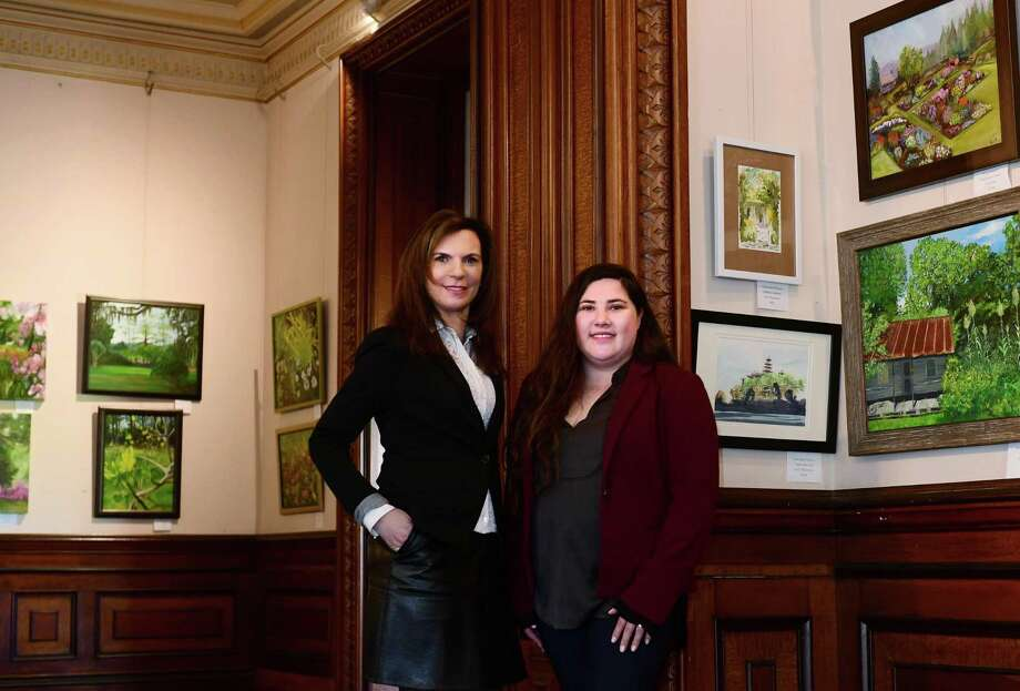 Executive Director Susan Gilgore and Manager of Museum Services Jennifer Feliciano unveil the new juried exhibit at Lockwood Matthews Mansion, Historic Grounds & Modern Gardens, Thursday April 11, 2019, features the work of 18 regional artists on the theme of historic grounds and modern gardens and will run through June 23 at the Mansion in Norwalk, Conn. Photo: Erik Trautmann / Hearst Connecticut Media / Norwalk Hour