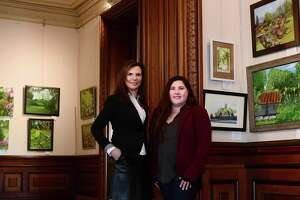 Executive Director Susan Gilgore and Manager of Museum Services Jennifer Feliciano unveil the new juried exhibit at Lockwood Matthews Mansion, Historic Grounds & Modern Gardens, Thursday April 11, 2019, features the work of 18 regional artists on the theme of historic grounds and modern gardens and will run through June 23 at the Mansion in Norwalk, Conn.