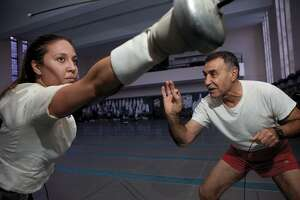 Former Yale University fencing coach Henry Harutunian instructs épéeist Alexia Cesar, Class of 2012, in this 2010 photo from the Yale Alumni Magazine. Harutunian was fired March 28 after 49 years.