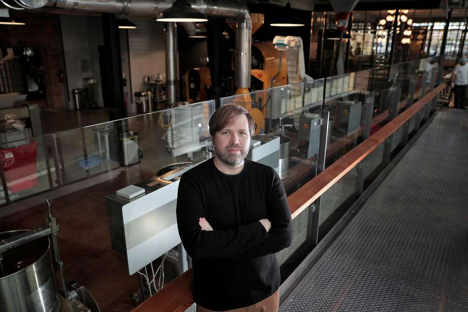 Todd Masonis, co-founder and CEO of Dandelion Chocolate, on the viewing path around the factory floor at the new factory, retail shop, cafe and full-service salon on Alabama Street in S.F. Photo: Carlos Avila Gonzalez / The Chronicle