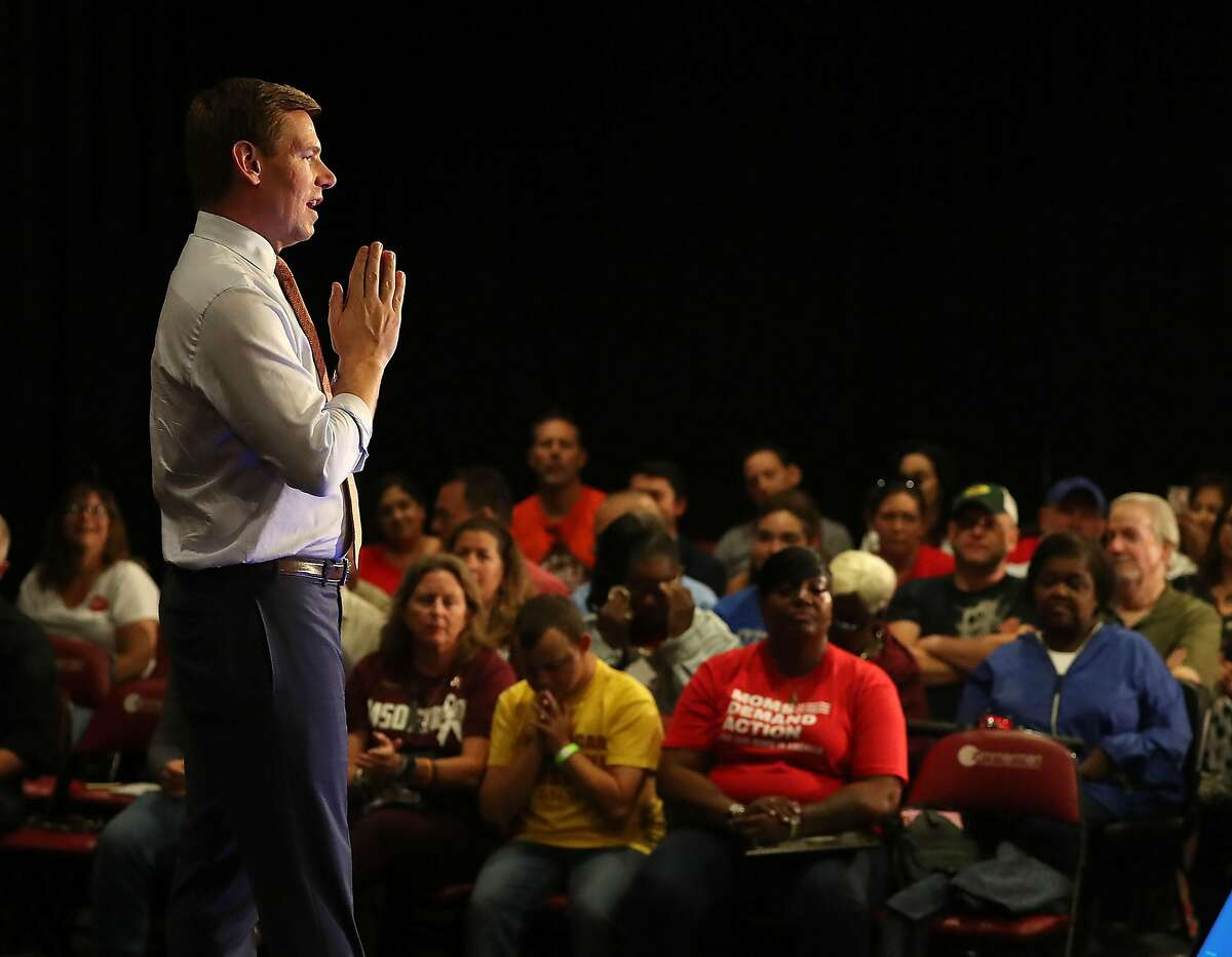 FILE - Rep. Eric Swalwell (D-CA), who announced that he is running for president in 2020, speaks during town hall on gun violence at the BB&T Center on April 09, 2019 in Sunrise, Florida. Rep. Swalwell held the town hall not far from Marjory Stoneman Douglas high school, which was the site of a mass shooting in 2018. He held a presidential campaign rally in his hometown of Dublin on Sunday.