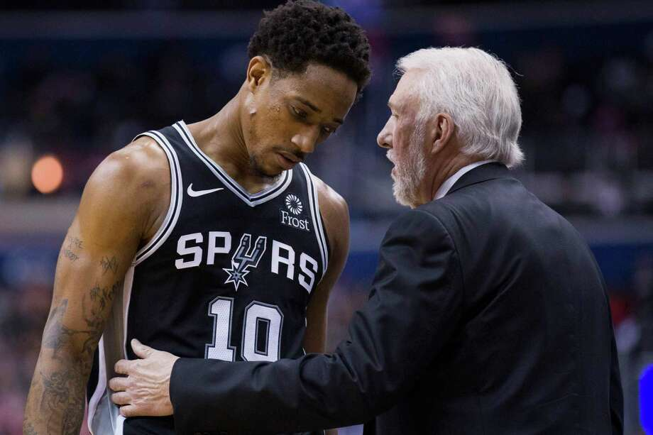 San Antonio Spurs guard DeMar DeRozan (10) listens to coach Gregg Popovich during the second half of the team's NBA basketball game against the Washington Wizards, Friday, April 5, 2019, in Washington. The Spurs won 129-112. Photo: Alex Brandon, AP / Copyright 2019 The Associated Press. All rights reserved.