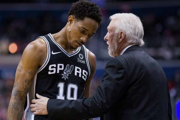 San Antonio Spurs guard DeMar DeRozan (10) listens to coach Gregg Popovich during the second half of the team's NBA basketball game against the Washington Wizards, Friday, April 5, 2019, in Washington. The Spurs won 129-112.