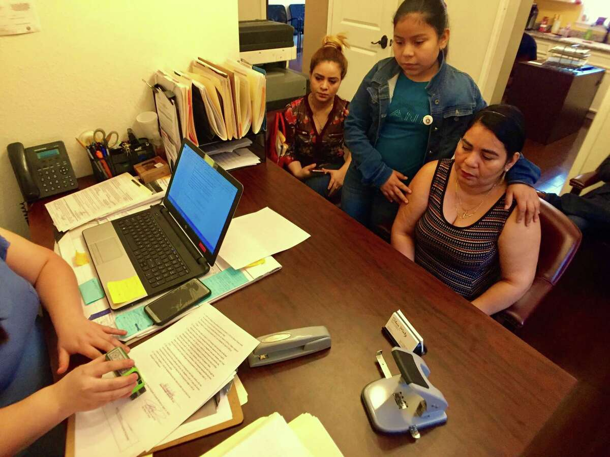 Dora Alvarado and her 11-year-old Laura Maradiaga wait in attorney Silvia Mintz's office for paperwork to be finalized regarding an effort to re-open Laura's immigration case and stop her deportation.