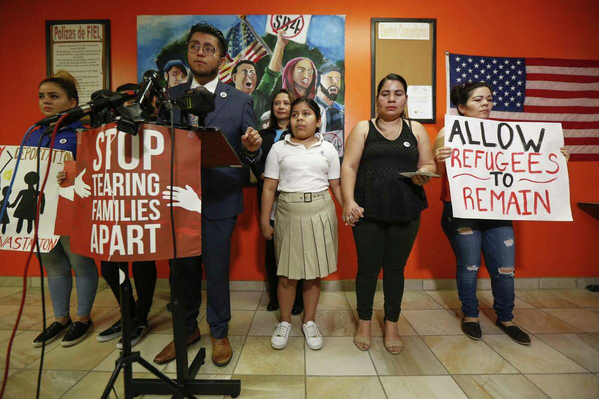 Cesar Espinosa, center, executive director at FIEL Houston Inc., talks about 11-year-old Laura Maradiaga, (third from right), who is facing deportation back to El Salvador Thursday, April 11, 2019, in Houston. From left to right, Laura's sisters, Katherine Maradiaga, 21, Adamaris Alvarado,15, immigration attorney Silvia Mintz, Laura's mother Dora Alvarado, and an aunt.