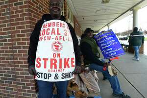 Workers with the UFCW-AFL-CIO Local 371 including Michael Fierson picket outside Stop and Shop on Connecticut Ave. as they continue their strike Friday, April 12, 2019, in Norwalk, Conn.