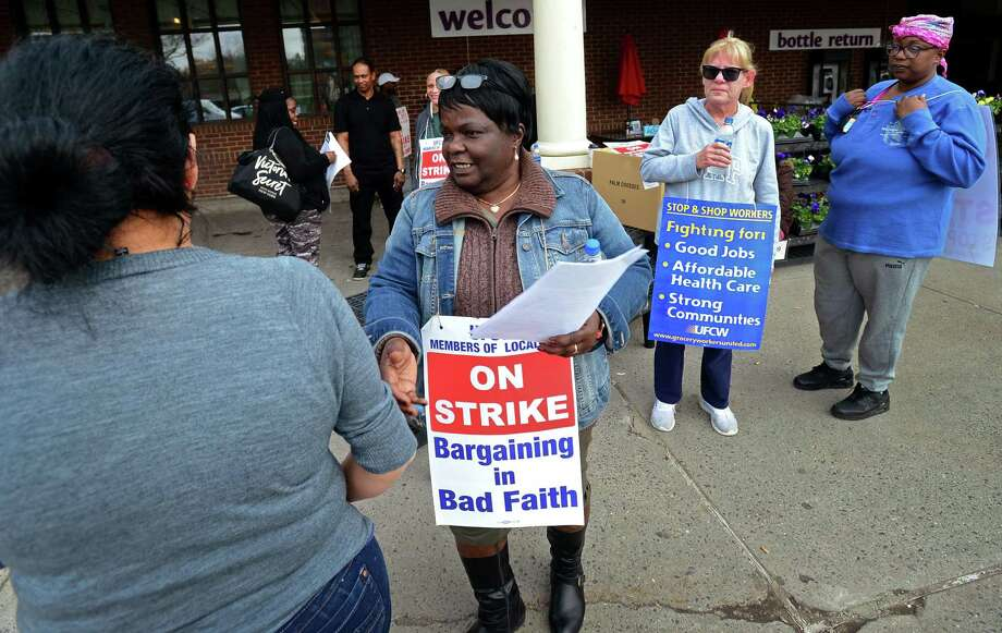 Workers with the UFCW-AFL-CIO Local 371 dissuade shoppiing at the store while they picket outside Stop and Shop on Main Ave. as they continue their strike Friday, April 12, 2019, in Norwalk, Conn. Photo: Erik Trautmann / Hearst Connecticut Media / Norwalk Hour