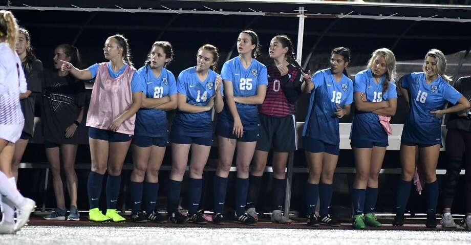 The Kingwood bench follows the action as the Lady Mustangs battle the Deer Park Lady Deer during the first half of their UIL Region III-6A Regional Quarterfinal State Soccer Playoff matchup at Turner Stadium in Humble on April 5, 2019. Photo: Jerry Baker/Contributor