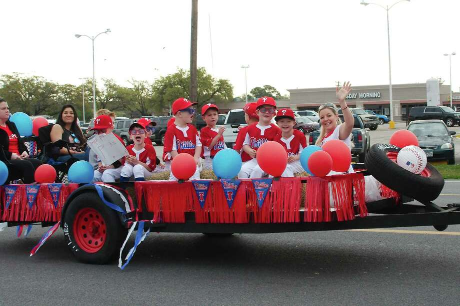 Members of the Friendswood Phillies baseball team wave to the crowd during a youth sports parade signifying the start of the season. Photo: Kirk Sides / Staff Photographer / © 2019 Kirk Sides / Houston Chronicle