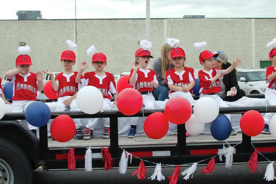 Members of the Friendswood Angels baseball team participate in a recent youth baseball parade. Photo: Kirk Sides / Staff Photographer / © 2019 Kirk Sides / Houston Chronicle