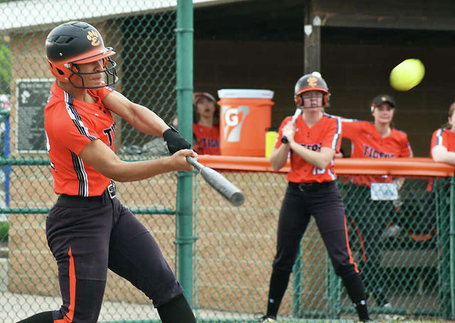Edwardsville shortstop Maria Smith muscles up for a home run against Alton on Wednesday inside the District 7 Sports Complex. Photo: Matt Kamp/The Intelligencer