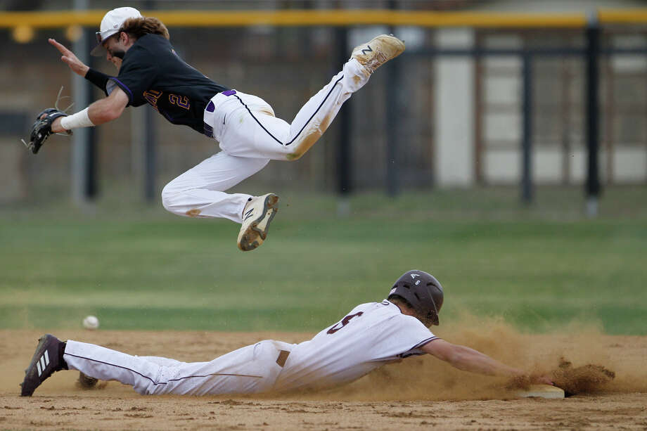Lee's Michael Weidner (6) returns to second base as Midland High's Tyler Wade (2) jumps over him April 12, 2019, at Ernie Johnson Field.  James Durbin / Reporter-Telegram Photo: James Durbin / Midland Reporter-Telegram / ? 2019 All Rights Reserved