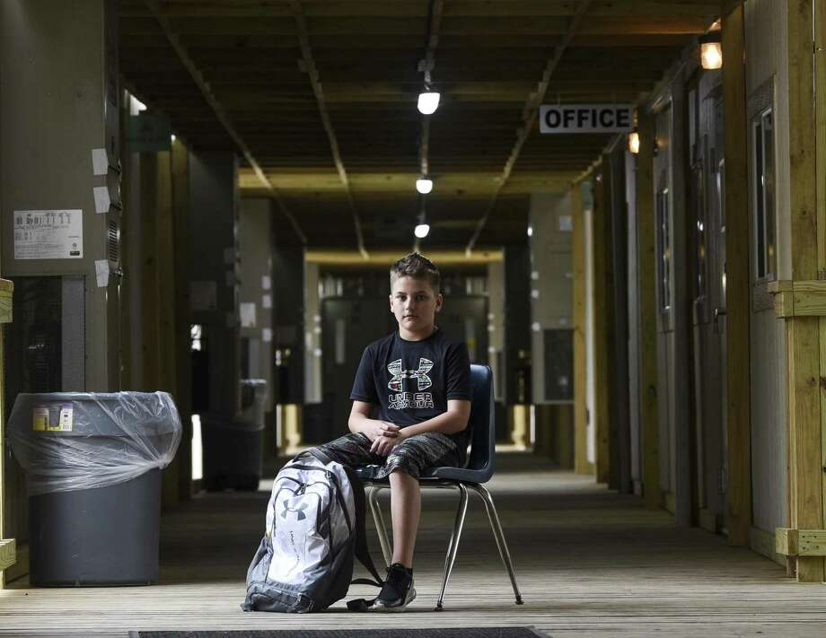 Hayden Seigrist, a 12-year-old sixth-grader, poses for a photo at Vidor Middle school's sixth-grade portable campus on the Vidor Middle school campus. He as been a student through both the re-purposed high school class rooms and the portable buildings due to damage from Harvey. Photo taken on Friday, 04/05/19. Ryan Welch/The Enterprise Photo: Ryan Welch / The Enterprise / ©Ryan Welch