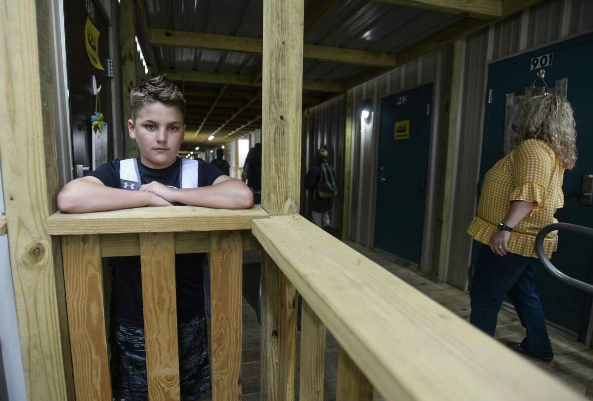 Hayden Seigrist, a 12-year-old sixth-grader, poses for a photo at Vidor Middle school's sixth-grade portable campus on the Vidor Middle school campus. He as been a student through both the re-purposed high school class rooms and the portable buildings due to damage from Harvey. Photo taken on Friday, 04/05/19. Ryan Welch/The Enterprise