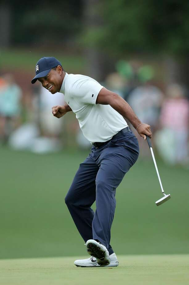 Tiger Woods celebrates after making a birdie putt on the 15th green in the second round at Augusta National Golf Club. Photo: David Cannon / Getty Images