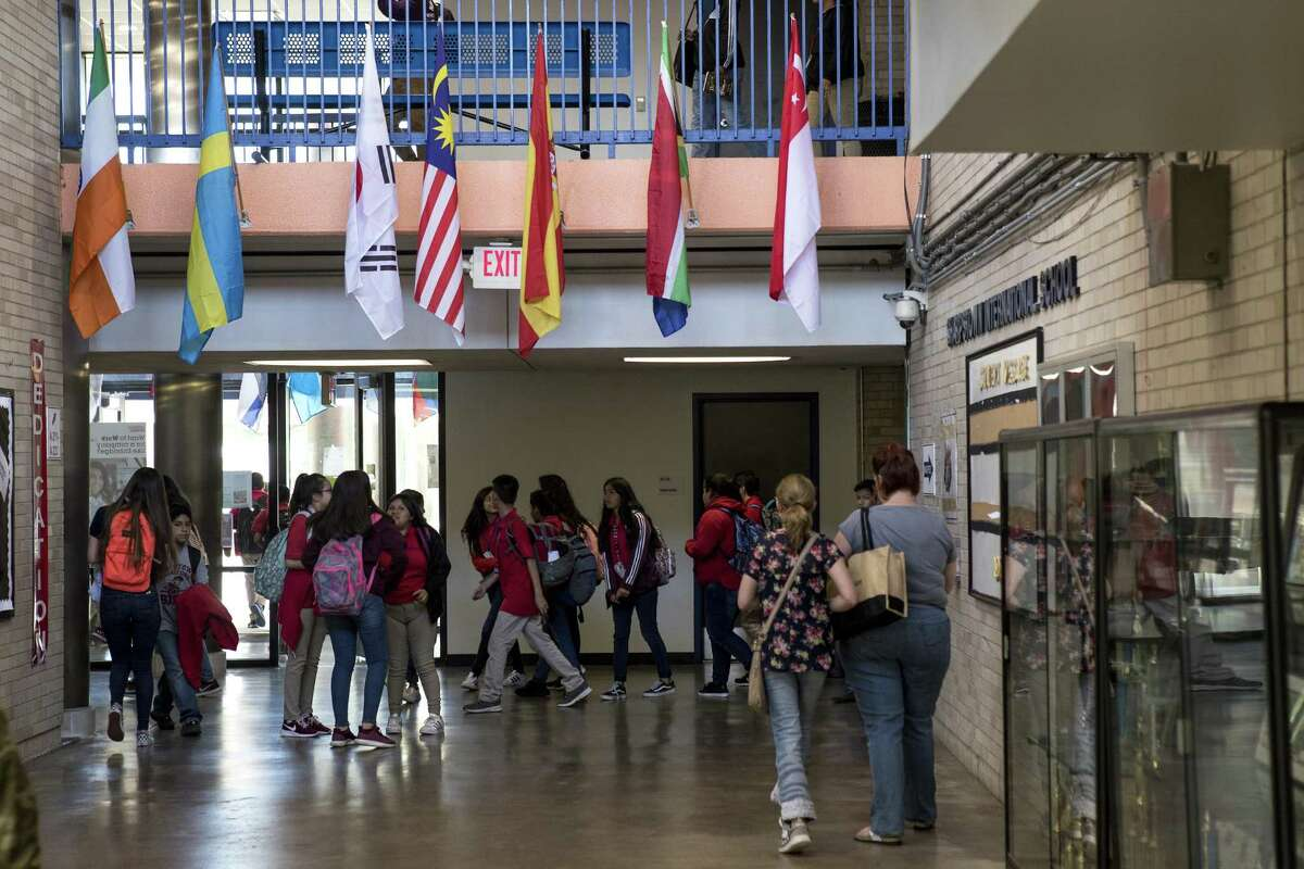 Students walk through the hallways at HISD's Sharpstown International School on Wednesday, May 9, 2018, in Houston. HISDs Sharpstown International School is the No. 8 ranked high school in the region in the report card, and the only school in the top 10 with more than 1,000 students. ( Brett Coomer / Houston Chronicle )