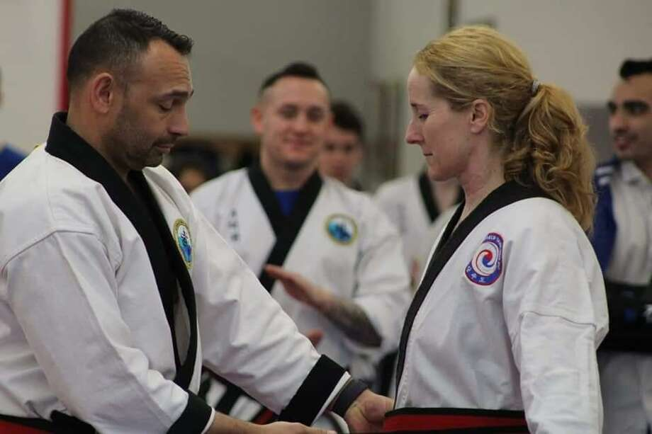 Ann Krantz, right, owner/instructor of Litchfield Tang Soo Do (LTSD). Krantz, who competed across the United States on the North American Sports Karate Associate (NASKA) circuit in 2018, earned three world titles in Traditional Forms, Weapons and Sparring competition. Photo: Contributed Photo /