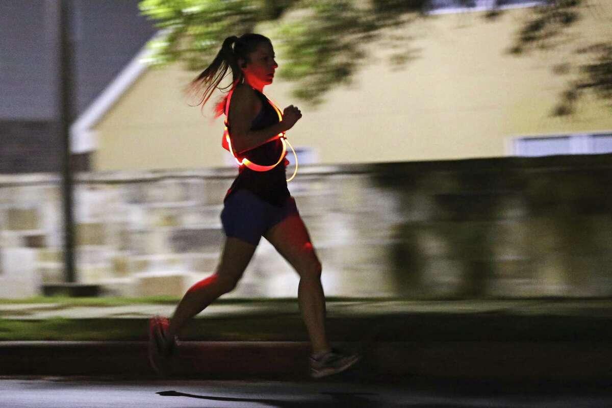 Kristin Johnson goes through her early morning training around her neighborhood in Northwest San Antonio. Johnson has qualified for the 2019 Boston Marathon.