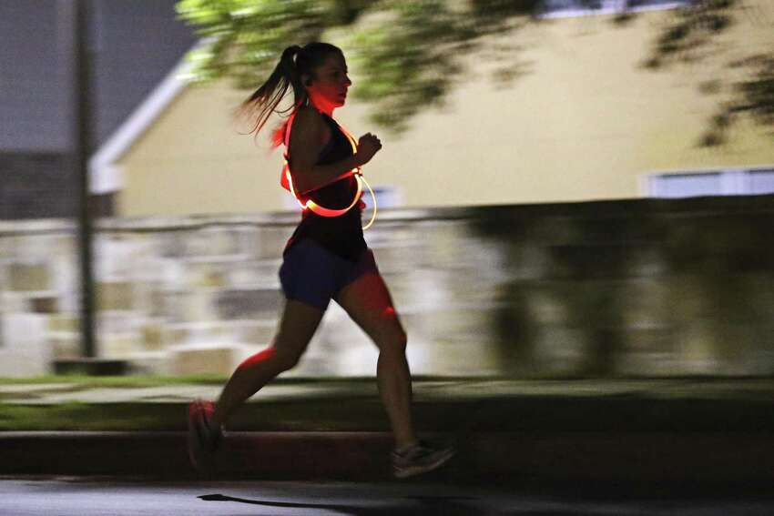Kristin Johnson goes through her early morning training around her neighborhood in Northwest San Antonio. Johnson has qualified for the 2019 Boston Marathon.