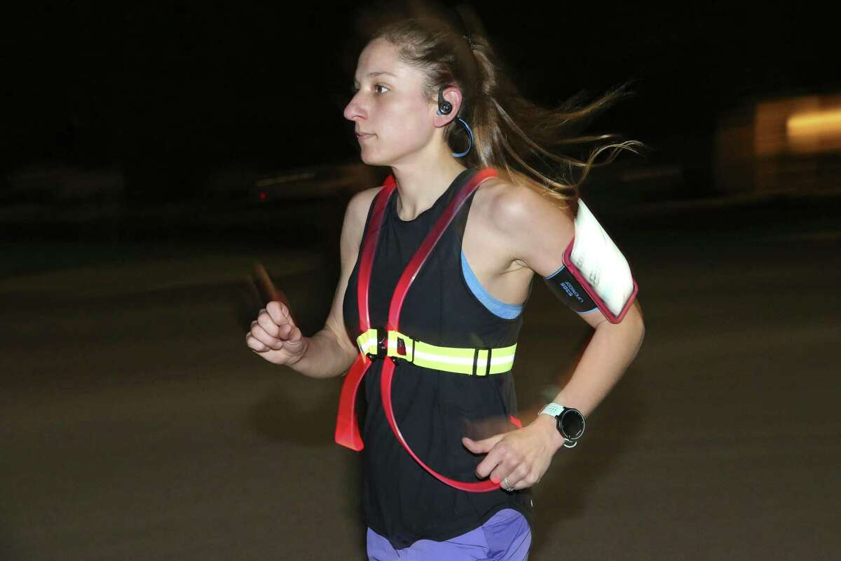 Kristin Johnson goes through her early morning running drills around her neighborhood in Northwest San Antonio, Tuesday, April 9, 2019. Johnson's journey to qualifying for the 2019 Boston Marathon included running the Louisiana Marathon, while 10 weeks pregnant with her first child. She missed qualifying for the Boston Marathon by 175 seconds. Seventeen months later she ran the San Antonio Rock 'n' Roll Marathon qualifying for the Boston Marathon with a time of 3 hours and 29 minutes. She continued training through her 38th week of pregnancy and resumed training for the upcoming marathon six weeks after her son was born on Oct. 13, 2018.