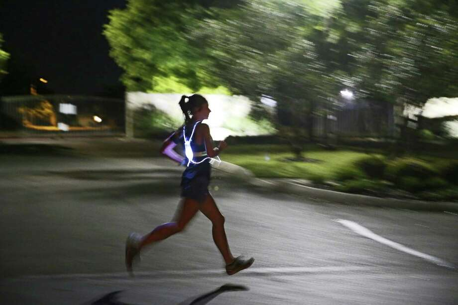 Kristin Johnson goes through her early morning running drills around her neighborhood in Northwest San Antonio, Tuesday, April 9, 2019. Johnson's journey to qualifying for the 2019 Boston Marathon included running the Louisiana Marathon, while 10 weeks pregnant with her first child. She missed qualifying for the Boston Marathon by 175 seconds. Seventeen months later she ran the San Antonio Rock 'n' Roll Marathon qualifying for the Boston Marathon with a time of 3 hours and 29 minutes. She continued training through her 38th week of pregnancy and resumed training for the upcoming marathon six weeks after her son was born on Oct. 13, 2018. Photo: Jerry Lara, Staff / Staff Photographer / © 2019 San Antonio Express-News