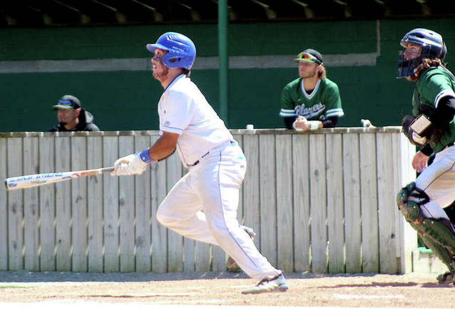 Ashton Smith of LCCC, as well as John Wood College players, watch as his double sails to deep centerfield in the third inning of the first game Friday's doubleheader in Godfrey. The hit was originally a triple, but the ball became lodged in the ivy at the base of the centerfield fence and it was ruled a ground-rule double. Smith, who later scored in the inning, was seven-for-eight at the plate in the twinbill split. JWC won the opener 8-7 in nine innings, but LCCC won the nightcap 12-2 in five innings. Photo: Pete Hayes | The Telegraph