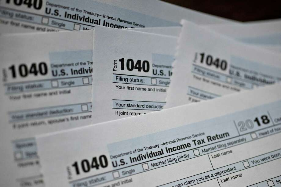U.S. Department of the Treasury Internal Revenue Service (IRS) 1040 Individual Income Tax forms for the 2018 tax year are arranged for a photograph in Tiskilwa, Illinois, U.S., on Monday, March 11, 2019. Photographer: Daniel Acker/Bloomberg Photo: Daniel Acker / © 2019 Bloomberg Finance LP