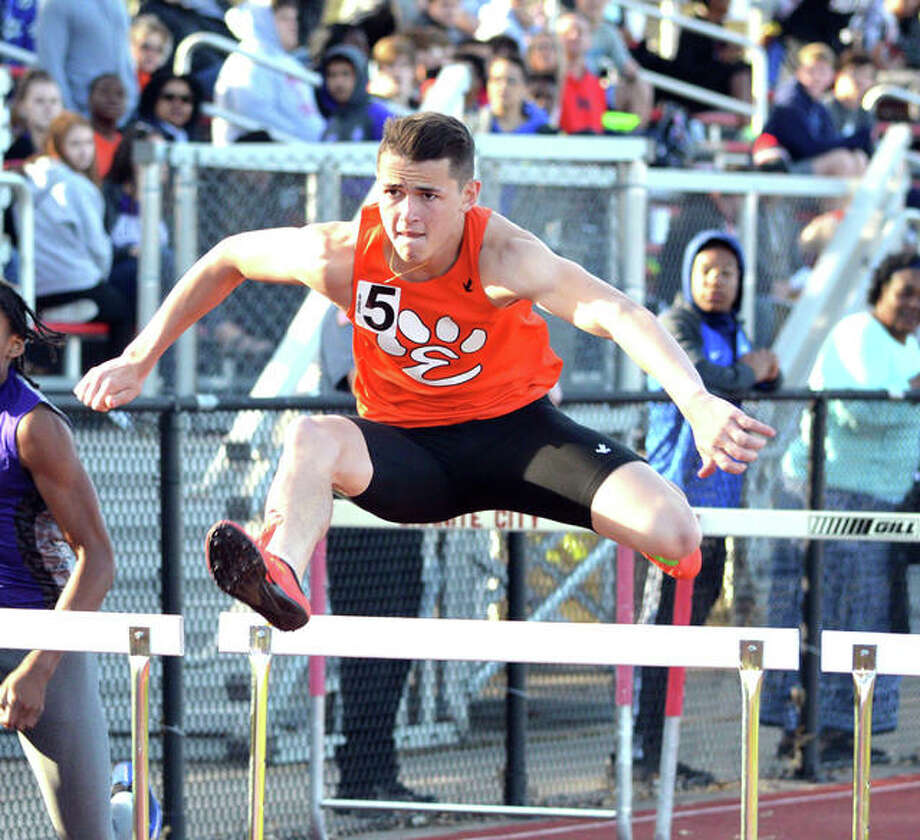 Edwardsville's Dan Powell competes in the 110-meter hurdles on Friday at the Granite City Invitational. Photo: Scott Marion/Intelligencer