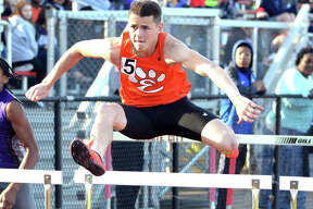 Edwardsville's Dan Powell competes in the 110-meter hurdles on Friday at the Granite City Invitational.