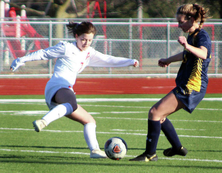 Alton's Alaina Nasello, left, scored three goals in her teams 4-0 victory over Oakville. Mo. Friday at AHS. she is shown in action earlier this season against O'Fallon. Photo: Pete Hayes | The Telegraph