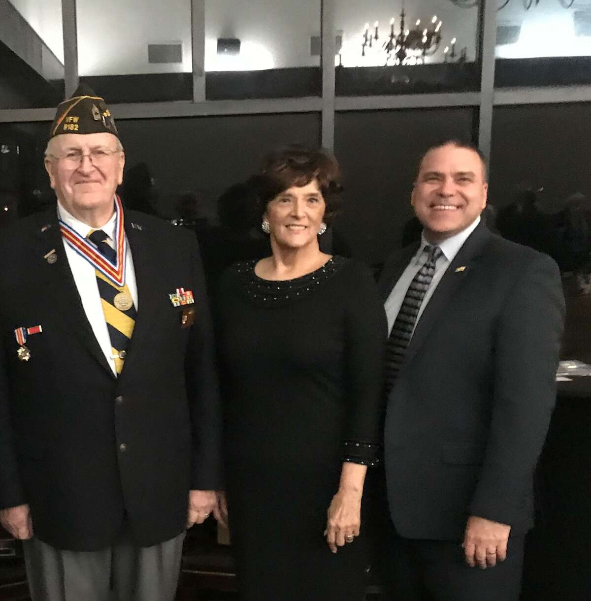 Phyllis Nawrot, a seventh-grade social studies teacher at Cardiff Junior High, received the Citizenship Education Teacher of the Year Award from Katy Veterans of Foreign Wars Post 9182. With her areKaty VFW Post 9182 Commander Don Byrne, left, and Katy Independent School District SuperintendentKenneth Gregorski.