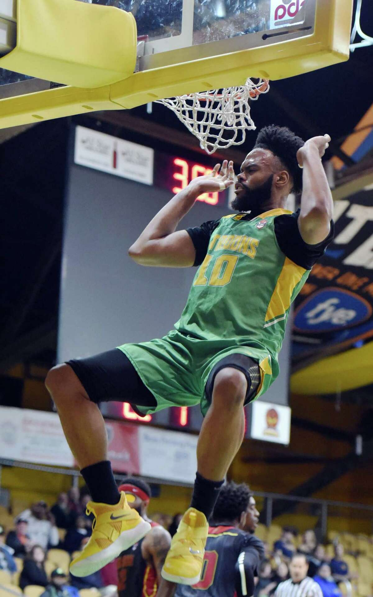 Albany Patroons center Alonzo Murphy dunks the ball during a game against Raleigh on Friday, April 12, 2019 at the Washington Avenue Armory in Albany, NY. (Phoebe Sheehan/Times Union)