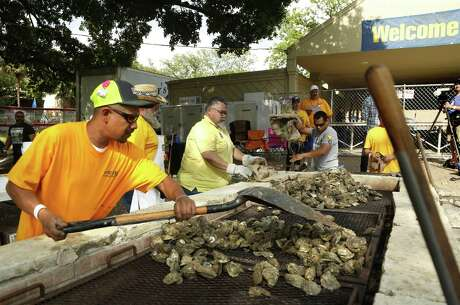 Volunteers prepare the Oysters. Oyster Bake at St. Mary's University on Friday, April 12 , 2019.