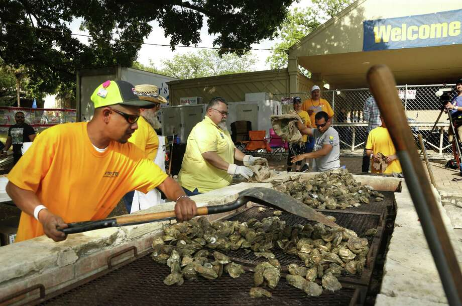 Volunteers prepare the Oysters. Oyster Bake at St. Mary's University on Friday, April 12 , 2019. Photo: Ronald Cortes/Contributor / 2019 Ronald Cortes