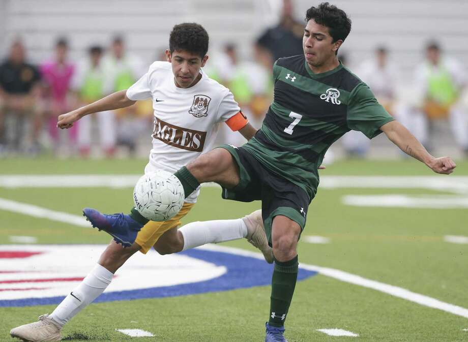The Rattler's Isaiah McAlinis steers the ball away from Sebastian Gonzalez as Reagan plays Brownsville Hanna in the Region IV-6A boys soccer tournament at Brownsville Sports Park on April 12, 2019. Photo: Tom Reel, Staff / Staff Photographer / 2019 SAN ANTONIO EXPRESS-NEWS