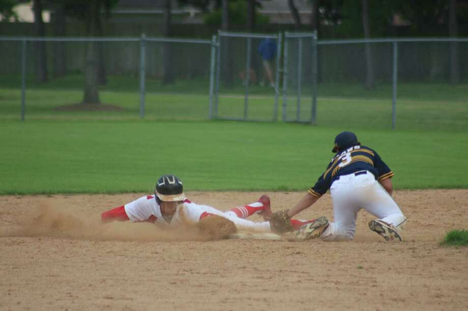 Jake Sweeney slides safely into second base with the steal as FBCA begins to stir the offense during first-inning action Friday. The team scored seven runs that frame and Sweeney batted twice. Photo: Robert Avery